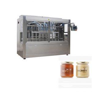 Macchina per il riempimento di 8 ugelli per controllo PLC, macchina per il riempimento di vasetti di vetro in vetro 400G